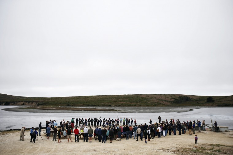 People gather for a ceremony during a celebration event at Drakes Bay Oyster Company in Inverness, California July 31, 2014. (Stephen Lam/Reuters)
