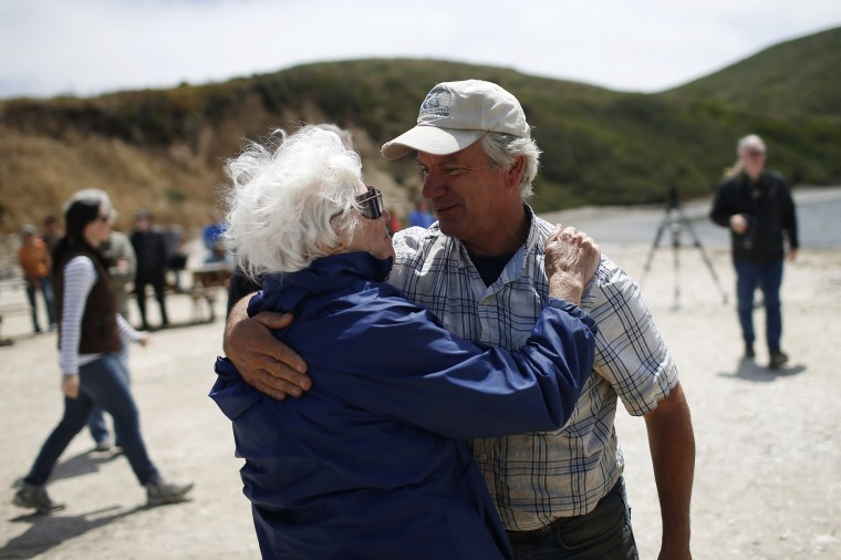 Kevin Lunny, owner of Drakes Bay Oyster Company, embraces a woman after a celebration ceremony in Inverness, California July 31, 2014. (Stephen Lam/Reuters)
