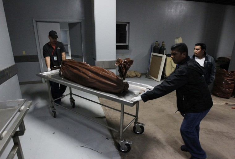 Forensic technicians wheel a stretcher with a body bag, containing the body of a young man who was shot by members of street gang Mara 18 for attempting to steal a motorcycle, at a morgue in Tegucigalpa August 15, 2014. Honduras and Nicaragua are among the most impoverished in the Americas, but Honduras is also blighted with the world's highest murder rate, at 90.4 homicides per 100,000 people, according to the United Nations, while Nicaragua's rate is just 11.3. (Jorge Cabrera/Reuters)