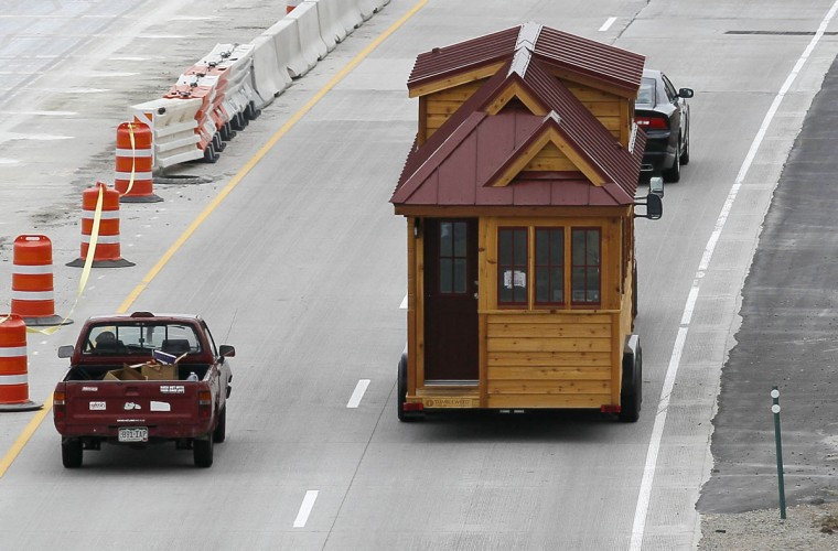 A Tumbleweed brand Cypress 24 model Tiny House is towed down the highway near Boulder, Colorado August 4, 2014. The Tiny House Movement started some years ago with people around the world building really small living spaces and loving their new simplified lives. These tiny houses can range from 1,000 square feet (93 square meters) down to less than 100 square feet (9.3 square meters), and are certainly not ramshackle shacks. (REUTERS/Rick Wilking)