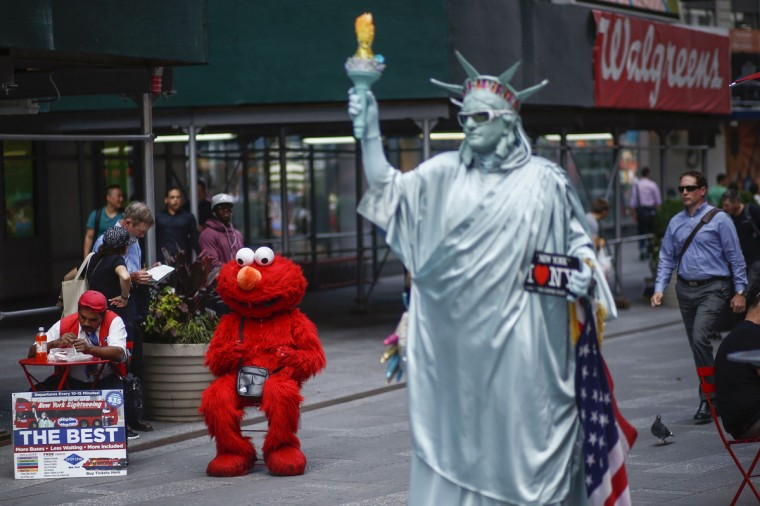 Jorge, an immigrant from Mexico, in Times Square, New York July 30, 2014. (Eduardo Munoz/Reuters)