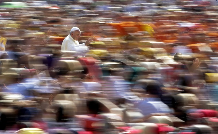 Pope Francis waves as he arrives to lead his weekly audience in Saint Peter's Square at the Vatican. (Max Rossi/Reuters)