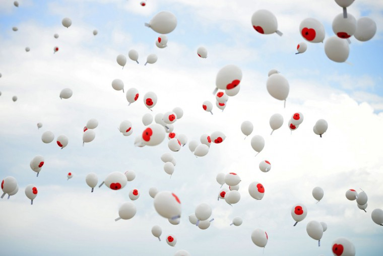 "Some 600 balloons emblazoned with a poppy and the name of a fallen soldier flutter in the sky during the ""Short Step"" ceremony, to mark the 100th anniversary of the outbreak of World War One (WW1), in Folkestone, southern England August 4, 2014. (Dylan Martinez/Reuters)"