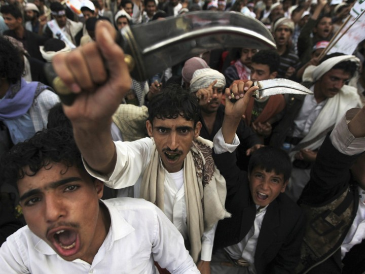 A protester chants slogans, as he waves his janbiya, a traditional dagger, as he marches during a demonstration organized by the Shi'ite Houthi movement to demand the government to rescind a decision to curb fuel subsidies in Sanaa August 21, 2014. Yemen raised fuel prices last month as the impoverished country tries to cut energy subsidies to ease the burden on its budget deficit. (Mohamed al-Sayaghi/Reuters)