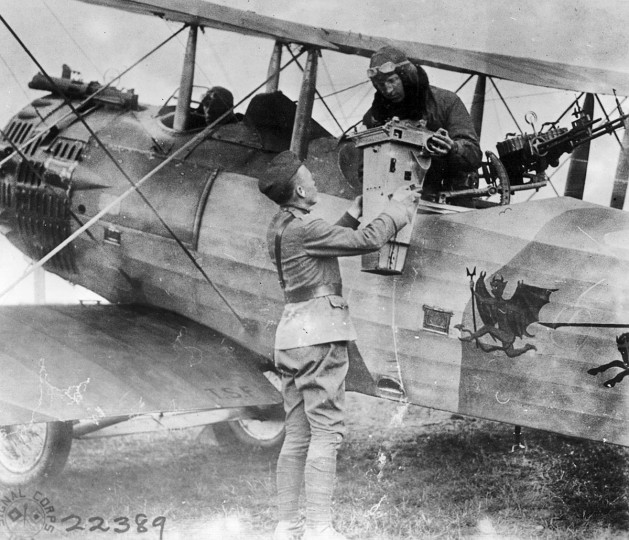 "An officer receives a camera and its film to be processed in the field in an undated photo from World War One. World War One pioneered many ""firsts"" in technological, scientific and societal innovations. Aircraft were deployed in war en masse for the first time, for both air to air combat and for reconnaissance. (REUTERS/Handout via National Defense Intelligence College)"