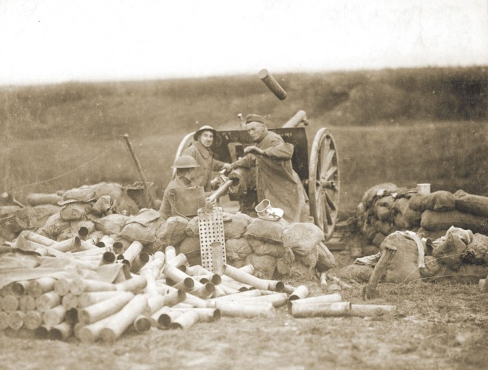 "U.S. artillerymen fire a 75mm gun toward Montsec from a position near Beaumont, France on September 12, 1918. World War One pioneered many ""firsts"" in technological, scientific and societal innovations. It was the first major war where a majority of casualties were inflicted by artillery. (REUTERS/Handout via U.S. National Archives)"