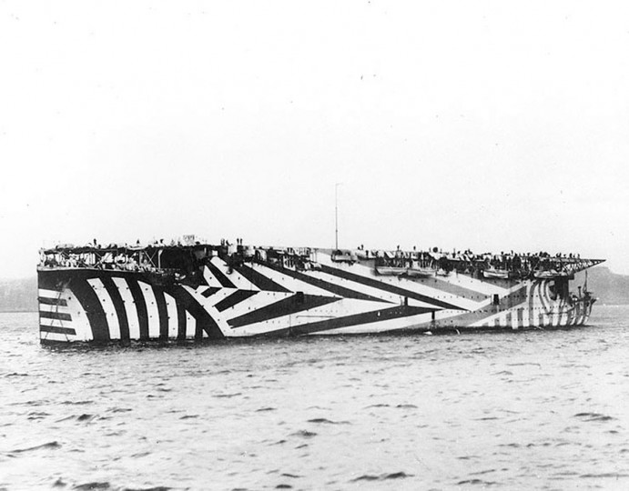 "The British aircraft carrier HMS Argus is seen in British waters, circa late 1918, painted in wartime ""dazzle"" camouflage. World War One pioneered many ""firsts"" in technological, scientific and societal innovations. Aircraft carriers were used for the first time, with the HMS Argus setting the template for future carriers capable of allowing planes to both take off and land on ships. (REUTERS/Handout via U.S. Naval Historical Center)"