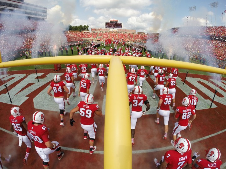 The North Carolina State Wolfpack run onto the field prior to their game against the Georgia Southern Eagles at Carter-Finley Stadium in Raleigh, North Carolina. (Lance King/Getty Images)