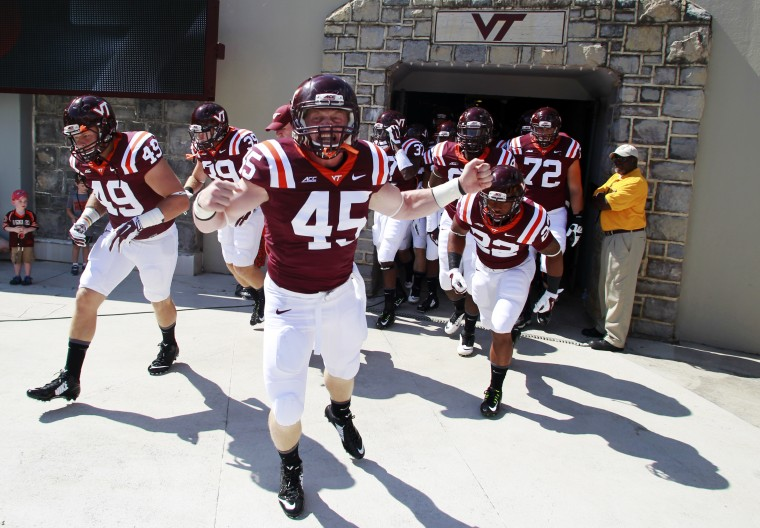 Virginia Tech Hokies fullback Sam Rogers (45) runs onto the field before the game against the William & Mary Tribe at Lane Stadium. (Peter Casey/USA Today Sports)