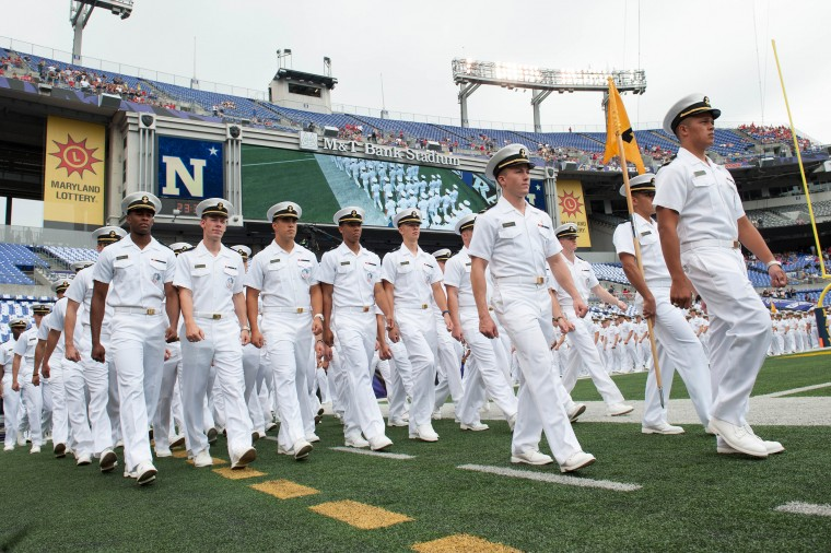 A group of U.S. Navy Midshipmen march onto the field before the game against the Ohio State Buckeyes at M&T Bank Stadium in Baltimore. (Tommy Gilligan/USA Today Sports)