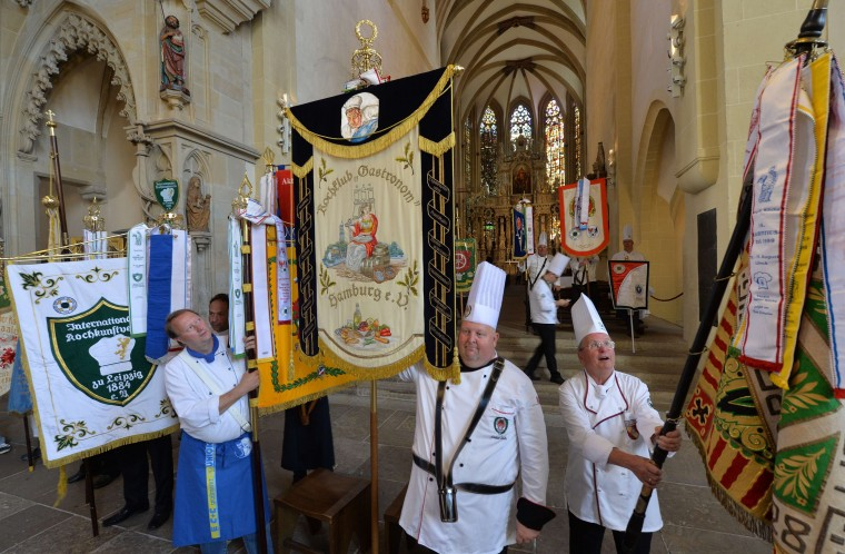Chefs take part in an oecumenical service on the occasion of the Laurentius day at the Cathedral in Erfurt, eastern Germany. The chefs from across the country met in honor of their patron saint Laurentius. (Hendrik Schmidt/AFP-Getty Images)