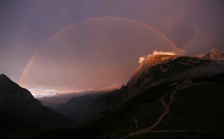A rainbow spans over the Hohes Goell (L) and Schneibstein mountains near the Carl-von-Stahl-Haus Alpine Club hut in the Berchtesgaden, Bavaria, Alpine region near the Austrian-German border. (Wolfgang Rattay/Reuters)