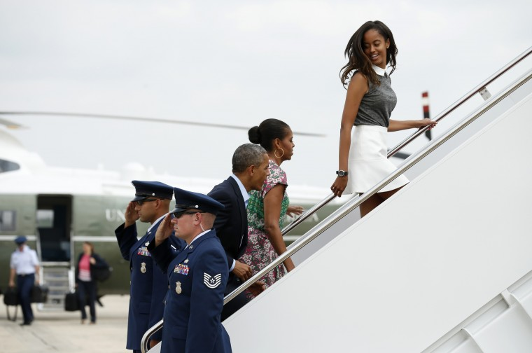 President Barack Obama, first lady Michelle Obama and daughter Malia (R) board Air Force One as they depart Joint Base Andrews in Maryland en route to Martha's Vineyard in Massachusetts for Obama's summer vacation. (Kevin Lamarque/Reuters)