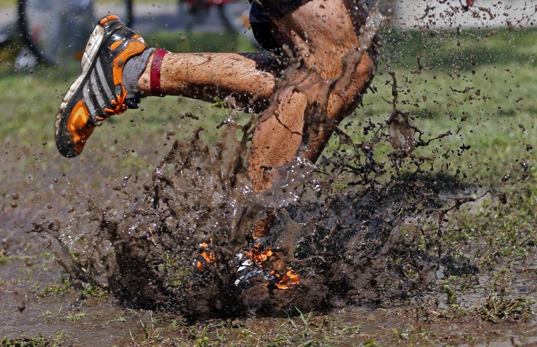A competitor runs through muddy water during the Brutal Run extreme obstacle course race in Budapest. (Laszlo Balogh/Reuters)