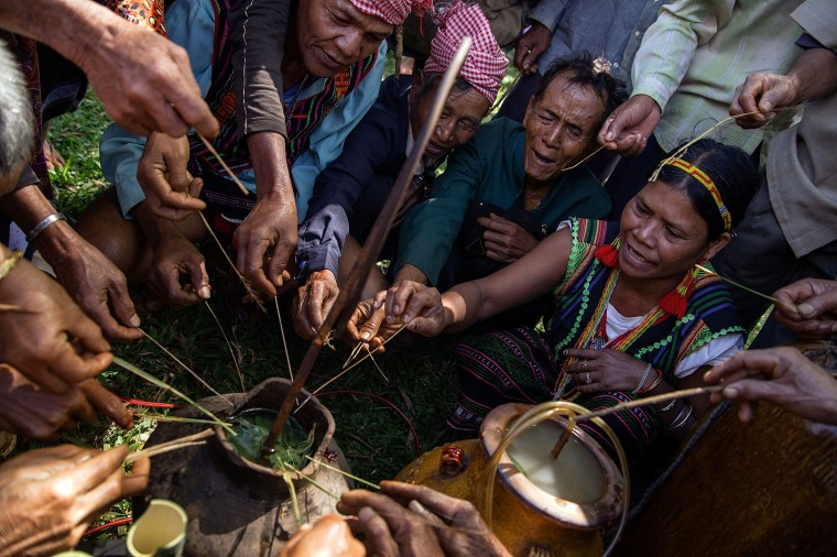 Members of the Bunong indigenous community perform a Bunong ritual before drinking wine in Mondulkiri, Cambodia. Cambodia's indigenous groups are at risk as their ancestral lands are being threatened by businesses interested in commercially developing the areas. On August 9, the UN focuses on the rights of the World's Indigenous People on International Indigenous People's Day. (Hannah Reyes/Getty Images)