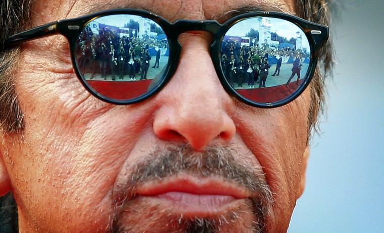 "Members of the media are reflected in the sunglasses of cast member Al Pacino as he attends the red carpet for the movie ""Manglehorn"" at the 71st Venice Film Festival. (Tony Gentile/Reuters)"