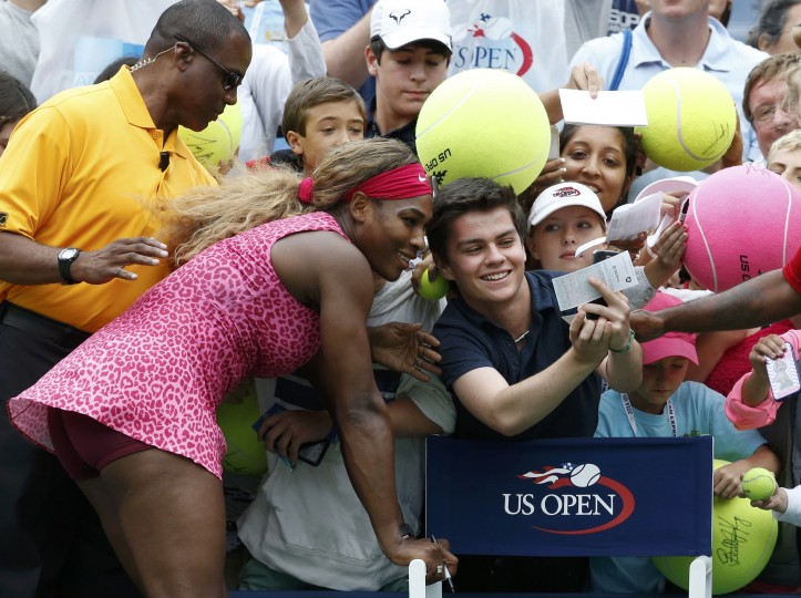 Serena Williams of the U.S. poses for a picture with a fan after her win over compatriot Varvara Lepchenko during their match at the 2014 U.S. Open tennis tournament in New York. (Ray Stubblebine/Reuters)