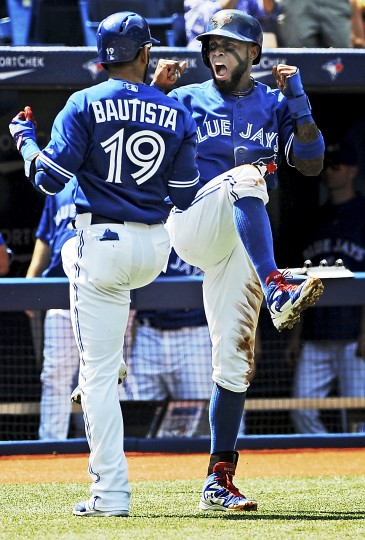 Toronto Blue Jays shortstop Jose Reyes (7) celebrates with right fielder Jose Bautista (19) after Bautista hit a two-run home run in the first inning against New York Yankees at Rogers Centre. (Dan Hamilton/USA Today Sports)