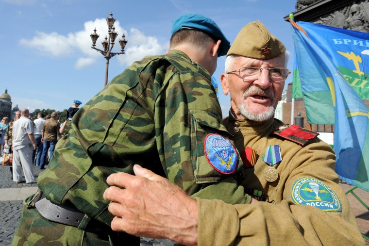 Russia's former soldiers of airborne forces celebrate the paratroopers day in St. Petersburg. Russians celebrate paratrooper day on Saturday, a tradition carried over from Soviet times. (Olga Maltseva/AFP-Getty Images)