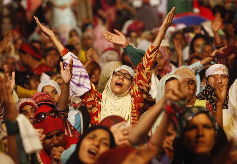 A supporter of Tahir ul-Qadri, Sufi cleric and leader of political party Pakistan Awami Tehreek, reacts as she listens to him praying outside the parliament house during the Revolution March in Islamabad. Thousands of protesters massed outside the residence of Pakistani Prime Minister Nawaz Sharif on Saturday to demand he step down, after efforts to find a negotiated solution to the country's political crisis failed. (Akhtar Soomro/Reuters)