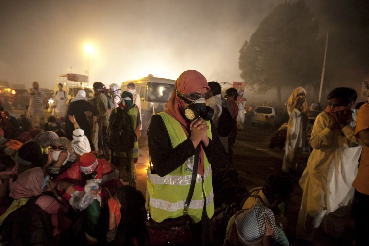 A supporter of Tahir ul-Qadri, Sufi cleric and leader of the Pakistan Awami Tehreek (PAT) political party, prays while wearing a gas mask, for protection from tear gas released by the police to disperse the supporters as they marched to the prime minister's house, in Islamabad. Thousands of protesters massed outside the residence of Pakistani Prime Minister Nawaz Sharif on Saturday to demand he step down, after efforts to find a negotiated solution to the country's political crisis failed. (Faisal Mahmood/Reuters)