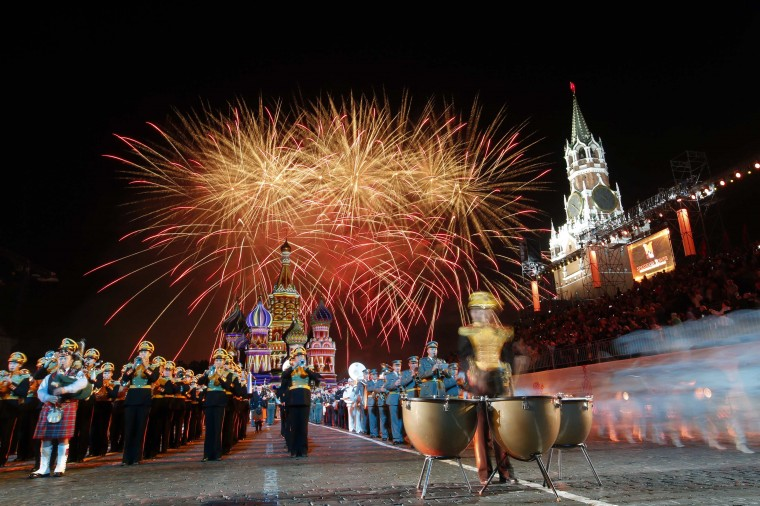 "Fireworks explode above Saint-Basil's cathedral during the first day of the International Military Music Festival ""Spasskaya Tower"" in Red Square in Moscow. Military bands from different countries will participate in the tattoo starting from August 30 to September 7. (Maxim Zmeyev/Reuters)"