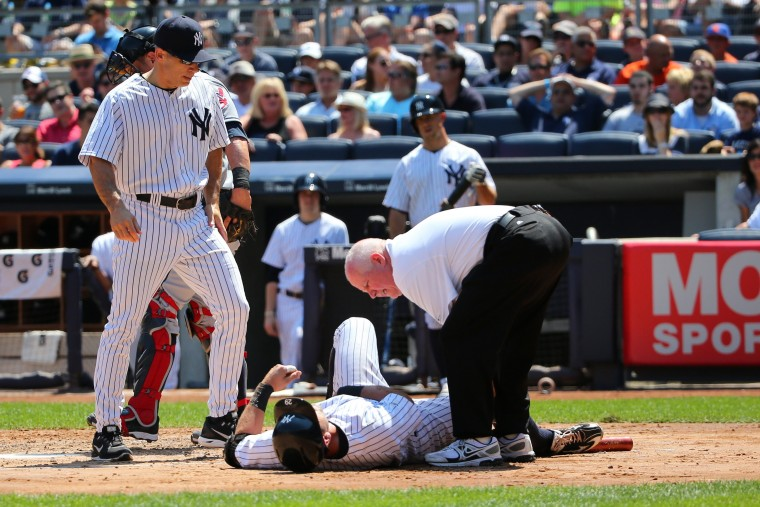 New York Yankees catcher Francisco Cervelli (29) is hit by a wild pitch thrown by Cleveland Indians starting pitcher Corey Kluber (28) during the third inning at Yankee Stadium. (Anthony Gruppuso/USA Today Sports)