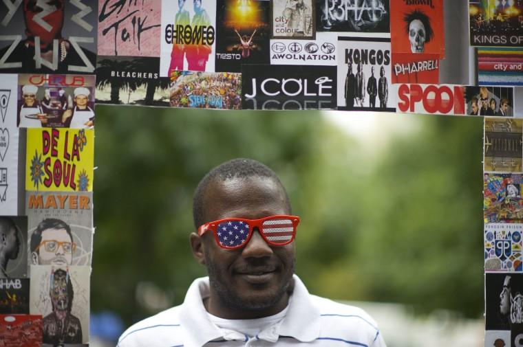 Raphael Drummond is photographed by friends in a frame at the Made in America festival in Philadelphia. The two day music festival is organized by Jay-Z and will have a twin concert in Los Angeles. (Mark Makela/Reuters)