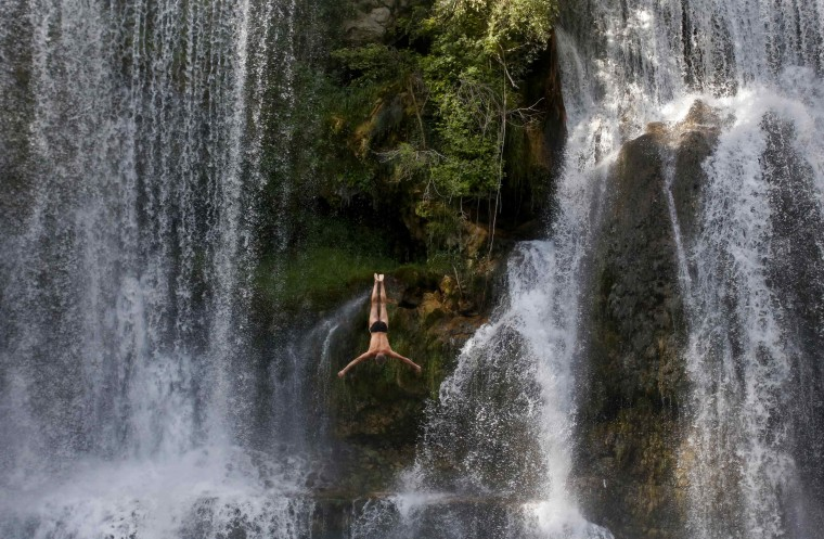 A competitor takes part in the first international waterfall jumping competition held in the old town of Jajce. (Dado Ruvic/Reuters)