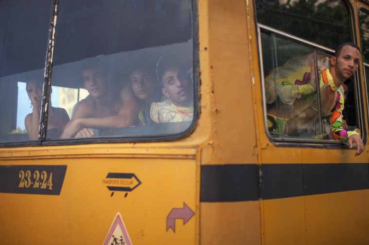 Revellers in a bus watch a fight taking place on a street before their performance at a carnival parade in Havana. (Alexandre Meneghini/Reuters)