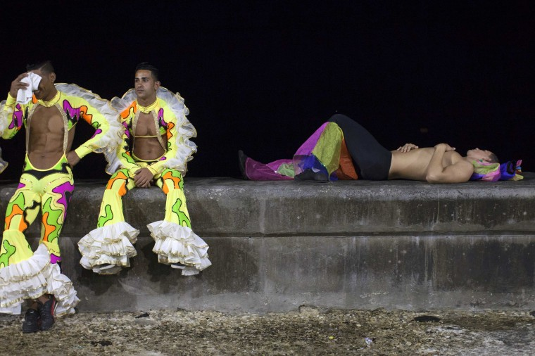 Revellers relax on a street before performing at a carnival parade in Havana. (Alexandre Meneghini/Reuters)