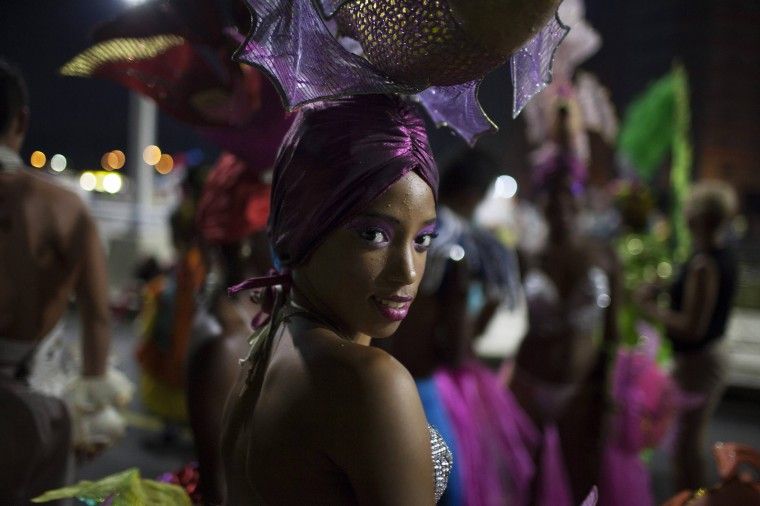 A reveller smiles before performing at a carnival parade in Havana. (Alexandre Meneghini/Reuters)