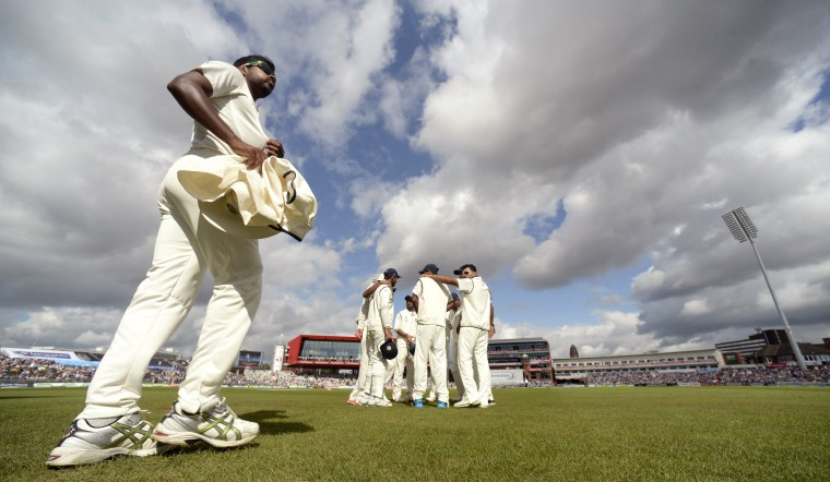 India's Varun Aaron walks out to join his team-mates before play during the fourth cricket test match against England at Old Trafford cricket ground in Manchester, England. (Philip Brown/Reuters)