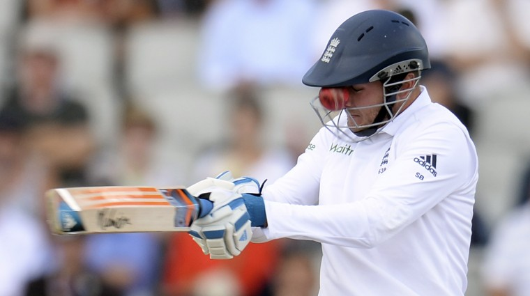 England's Stuart Broad edges the ball that gets stuck in the grill of his helmet from a delivery from India's Varun Aaron during the fourth cricket test match at Old Trafford cricket ground in Manchester. (Philip Brown/Reuters)