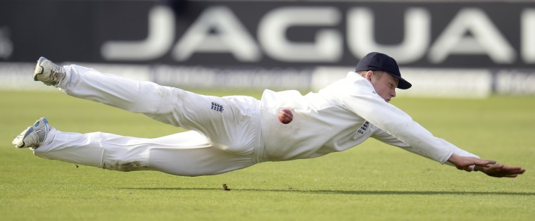 England's Sam Robson dives as he attempts to take a catch during the fourth cricket test match against India at Old Trafford cricket ground in Manchester, England. (Philip Brown/Reuters)
