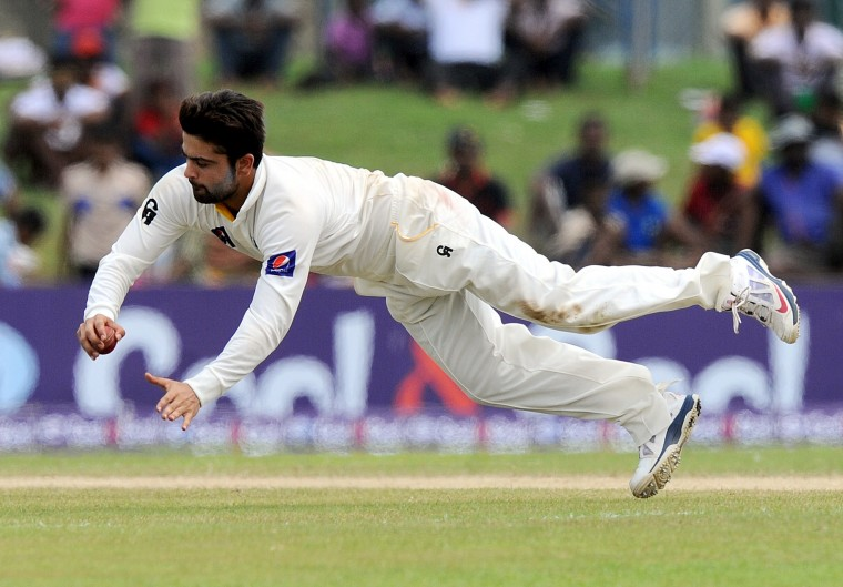 Pakistan cricketer Ahmed Shehzad stops the ball during the fourth day of the opening Test match between Sri Lanka and Pakistan at The Galle International Cricket Stadium in Galle. (Ishara S.Kodikara/AFP-Getty Images)