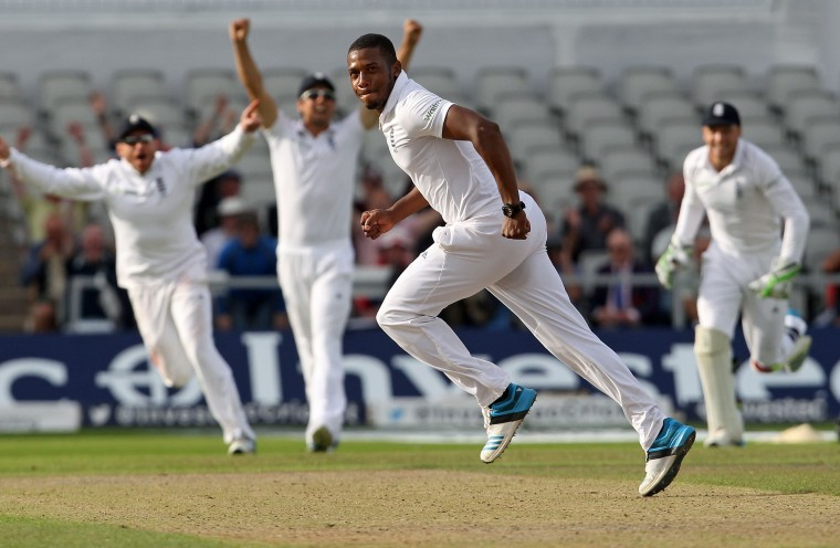 England's Chris Jordan celebrates taking the wicket of India's Pankaj Singh and to win the fourth cricket Test match between England and India at Old Trafford in Manchester (Lindsey Parnaby/AFP/Getty Images)