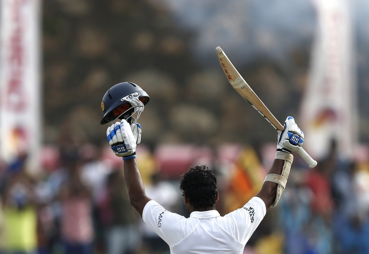 Sri Lanka's Kumar Sangakkara celebrates his double century during the fourth day of their first test cricket match against Pakistan in Galle. (Dinuka Liyanawatte/Reuters)