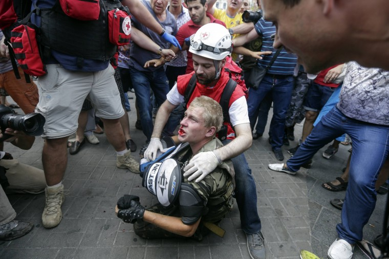 A protester receives medical treatment after clashes with municipal workers and volunteers at Independence Square in Kiev. Tensions continued on Kiev's Independence Square, the scene of street protests that toppled a Moscow-backed president in February, as protesters still camped there clashed with city workers who tried to clear away their tents. (Konstantin Chernichkin/Reuters)