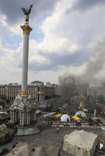 Barricades set on fire by protesters burn at Independence Square in Kiev. Tensions continued on Kiev's Independence Square, the scene of street protests that toppled a Moscow-backed president in February, as protesters still camped there clashed with city workers who tried to clear away their tents. (Konstantin Grishin/Reuters)