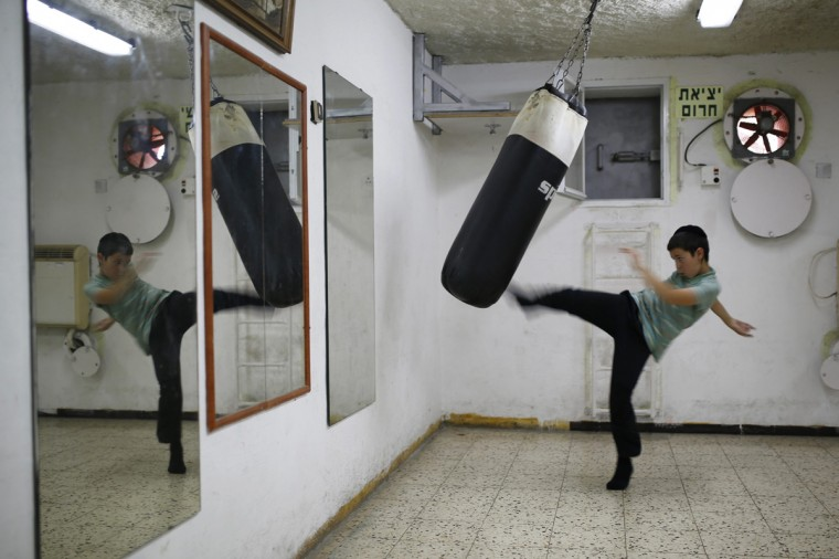 An Israeli boy plays in a bomb shelter in the Israeli southern city of Ashkelon July 31, 2014. Israel declared a Gaza ceasefire over on Friday, saying Hamas militants breached the truce soon after it came in effect and apparently captured an Israeli officer while killing two other soldiers. The 72-hour break announced by U.S. Secretary of State John Kerry and U.N. Secretary-General Ban Ki-moon was the most ambitious attempt so far to end more than three weeks of fighting, and followed mounting international alarm over a rising Palestinian civilian death toll. Picture taken July 31, 2014. (Amir Cohen/Reutrs)