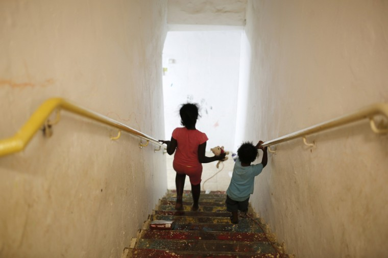 Israeli girls go down the stairs into a bomb shelter in the Israeli southern city of Ashkelon July 31, 2014. Israel declared a Gaza ceasefire over on Friday, saying Hamas militants breached the truce soon after it came in effect and apparently captured an Israeli officer while killing two other soldiers. The 72-hour break announced by U.S. Secretary of State John Kerry and U.N. Secretary-General Ban Ki-moon was the most ambitious attempt so far to end more than three weeks of fighting, and followed mounting international alarm over a rising Palestinian civilian death toll. Picture taken July 31, 2014. (Amir Cohen/Reutrs)