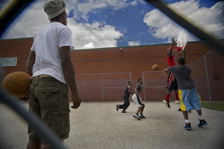 Youths play basketball at Park Heights Elementary School / CC Jackson Recreation Center, where money for slots proceeds are slated to benefit the Park Heights community near Pimlico Race Course Tuesday, June 14, 2011. (Karl Merton Ferron / Baltimore Sun Staff)