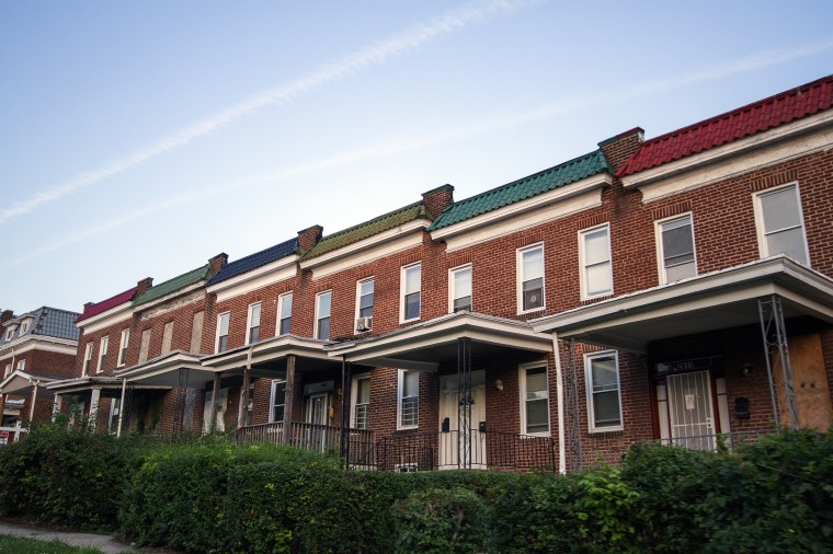 Pockets of Park Heights have undergone redevelopment through the years to demolish and rebuild rowhomes. Here, one remains boarded up while others have been revamped. (Kalani Gordon/The Baltimore Sun/August 2014)