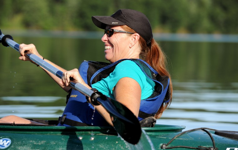 Mindy Grant, of Hanover, laughs as she embarks on the sunset kayak trip on the Piney Run Reservoir in Sykesville on Saturday, Aug. 16, 2014. (Jon Sham/BSMG)