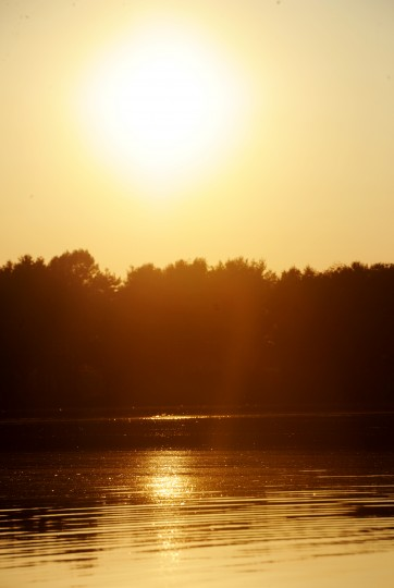 The sun sets over the Piney Run Reservoir in Sykesville during a kayak tour, Saturday, Aug. 16, 2014. (Jon Sham/BSMG)