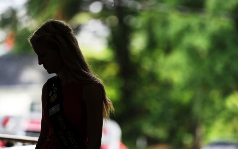 Laura Thomas, the 2013 winner of the Miss Howard County Farm Bureau contest, waits for the 2014 contestants to come into the pavilion so the winner among them can be announced at the Howard County Fair in West Friendship on Sunday, Aug. 3, 2014. (Jon Sham/BSMG)