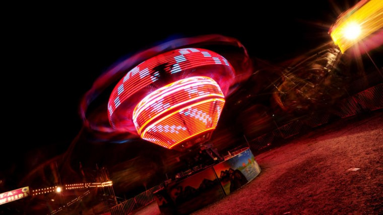 A whirling ride spins around at night at the Howard County Fair. (Jon Sham/BSMG)