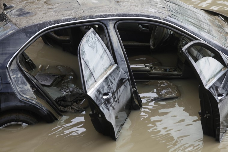 A vehicle sits submerged in water along I-75 August 12, 2014 in Royal Oak, Michigan. Severe rain from yesterday's storm flooded local streets, highways, and homes in the Detroit Metropolitan area experiencing the worst flash flooding in decades. (Photo by Joshua Lott/Getty Images)