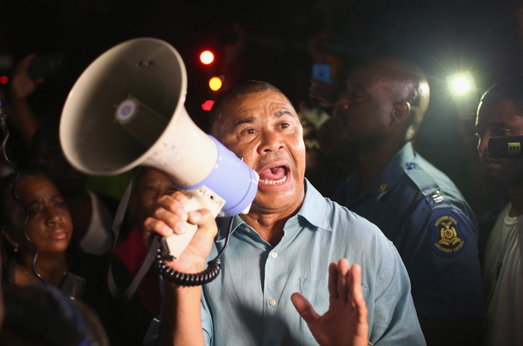 Congressman Lacy Clay (D-MO) speaks to demonstrators gathered along West Florissant Avenue to protest the shooting and death of Michael Brown on August 15, 2014 in Ferguson, Missouri. Brown was shot and killed by a Ferguson police officer on August 9. Tonight's demonstration again ended with protestors clashing with police followed by more looting. (Photo by Scott Olson/Getty Images)